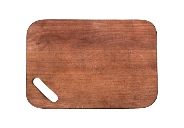 Tabla de cortar de madera marrón con una ranura para sujetar