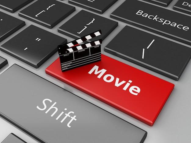 Tablero de claqueta del cine 3d en el teclado de la computadora.
