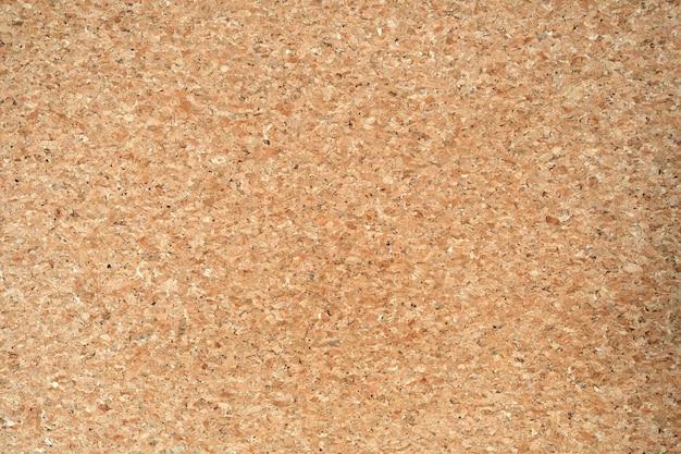 Tablero de corcho de color natural en blanco textura de fondo abstracto beige simple