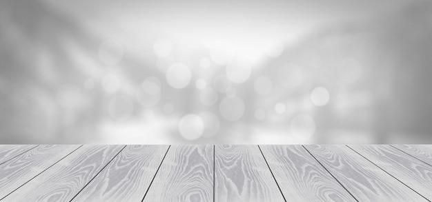 Tablero de madera gris sobre fondo borroso