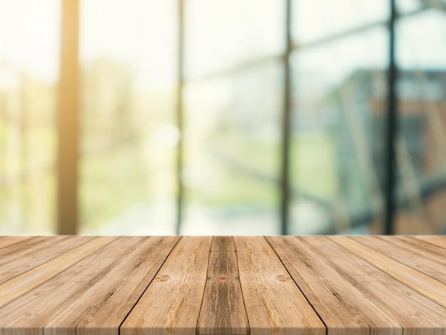 Tablero de madera mesa vacía en el fondo borroso