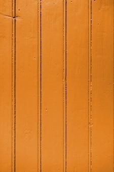 Tablero de madera vieja pintada fondo naranja