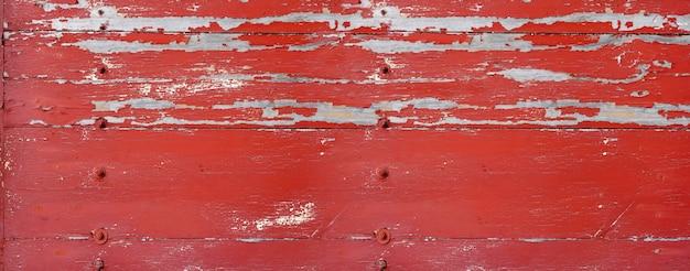 Tablero de madera vieja pintada de rojo. antecedentes