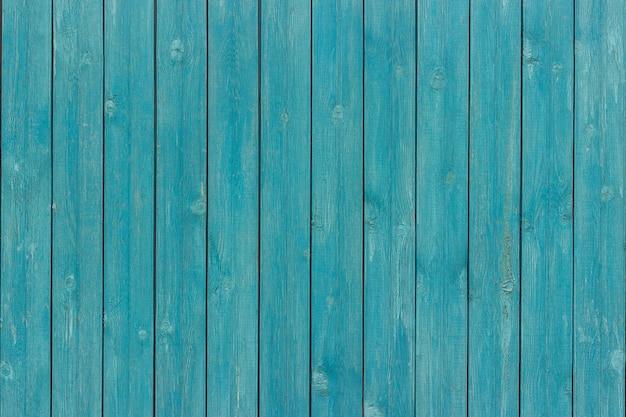 Tablero de tablones de madera vieja pintado de color azul.