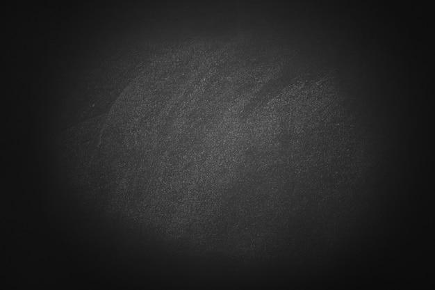 Tablero de tiza de textura oscura y fondo de tablero negro