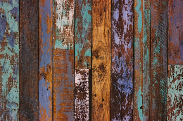 Tableros pintados viejos coloreados agrietados