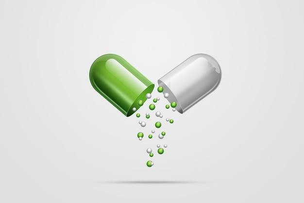Una tableta en forma de cápsulas de color verde,