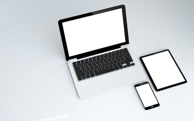 Tableta, laptop y smartphone con pantalla blanca.