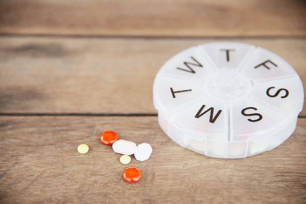 Tableta de medicina en pastillero