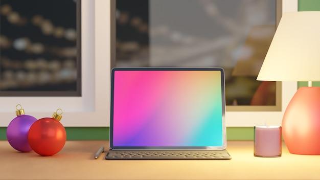 Tableta de pantalla grande con caja, teclado, lápiz, bola de navidad, vela y lámpara blanca colocada sobre la mesa de madera y el fondo de las ventanas. imagen de renderizado 3d.
