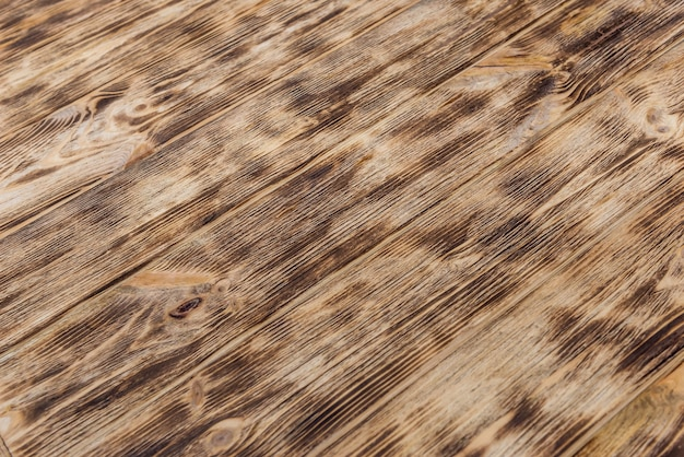 Tablón de madera con textura utilizada como fondo de cerca