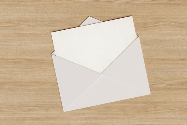Tarjeta en blanco saliendo de un sobre.
