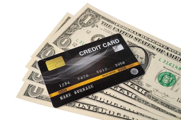 Tarjeta de crédito en billetes de dólar estadounidense, desarrollo financiero, contabilidad, estadísticas, análisis de inversiones, datos de investigación, economía, oficina, concepto de banca de la empresa comercial.