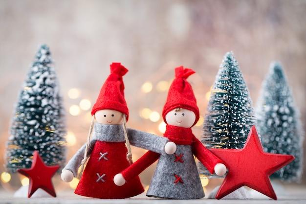 Tarjeta de felicitación de navidad. fondo festivo de gnomo. símbolo de año nuevo.
