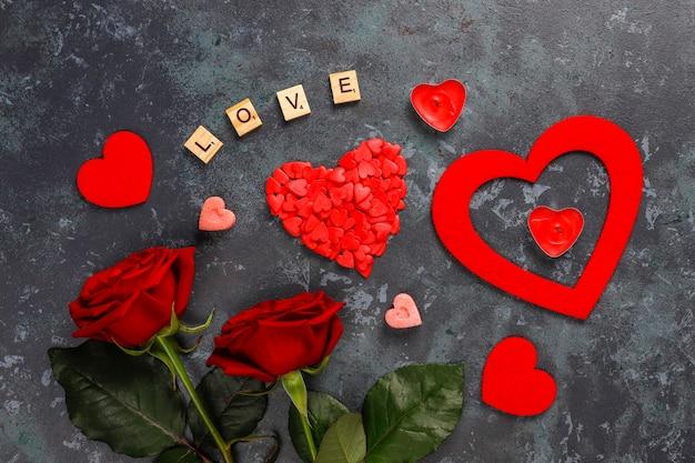 Tarjeta de felicitación de san valentín con flores color de rosa.