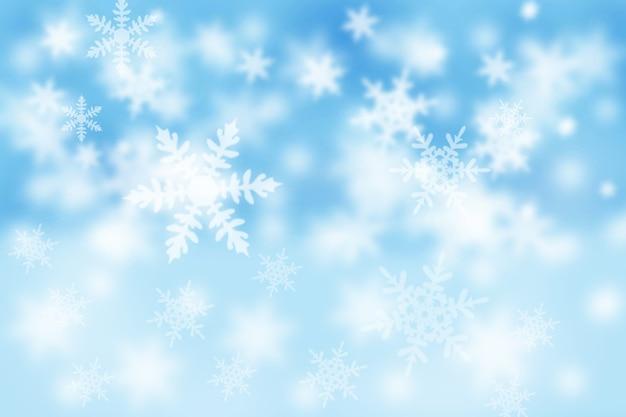 Tarjeta de navidad y año nuevo con copos de nieve. fondo de nieve azul de invierno.
