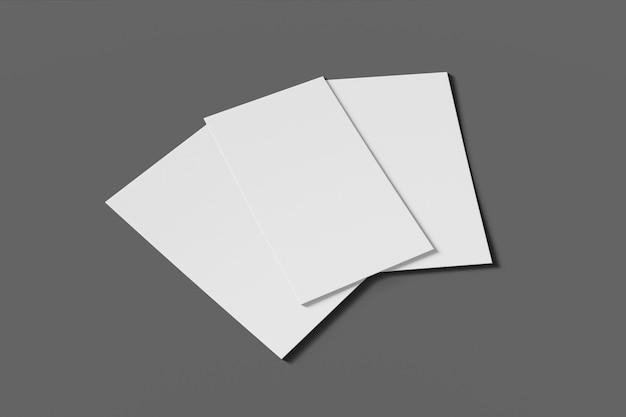 Tarjeta de negocios o nombre en blanco de tres maquetas sobre un fondo gris. renderizado 3d