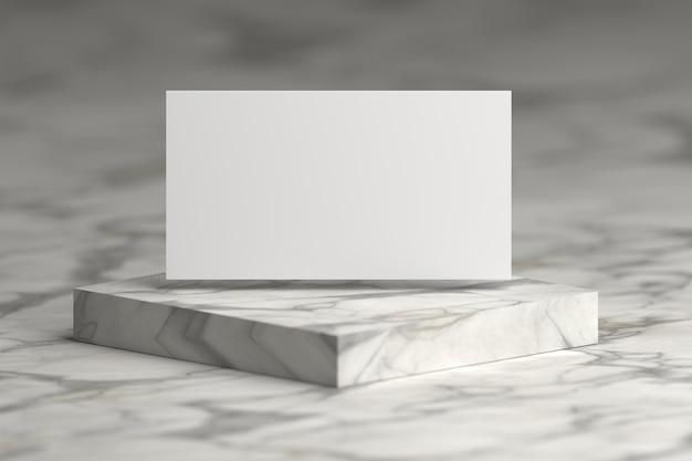 Tarjeta de presentación en blanco volando sobre podio de mármol.