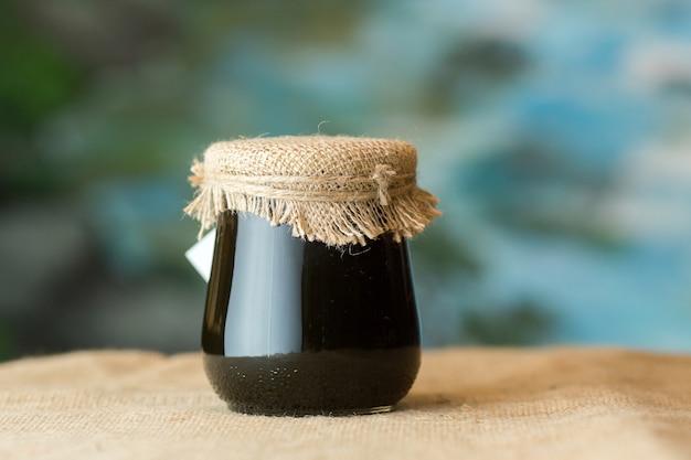 Tarro de miel de vidrio