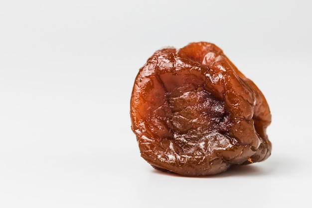 Tasty raisin on white background