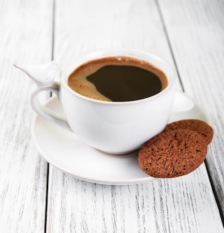 Taza de cafe y galletas
