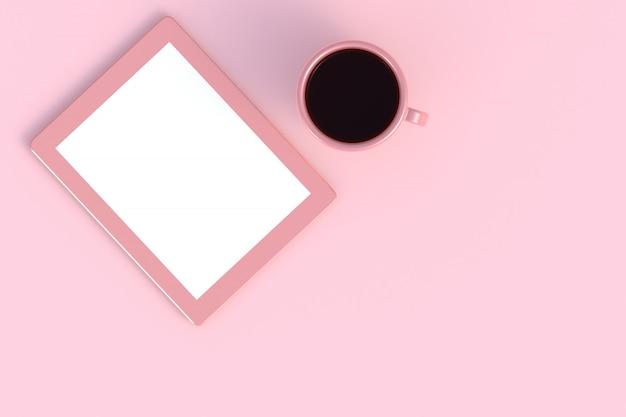 Taza de café con tableta en rosa