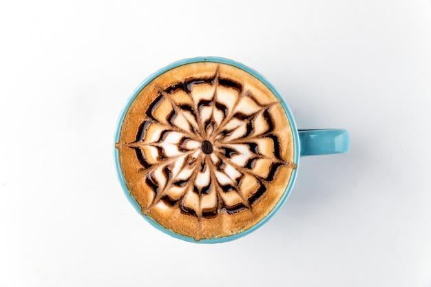 Taza de café tela de araña decorada con capuchino