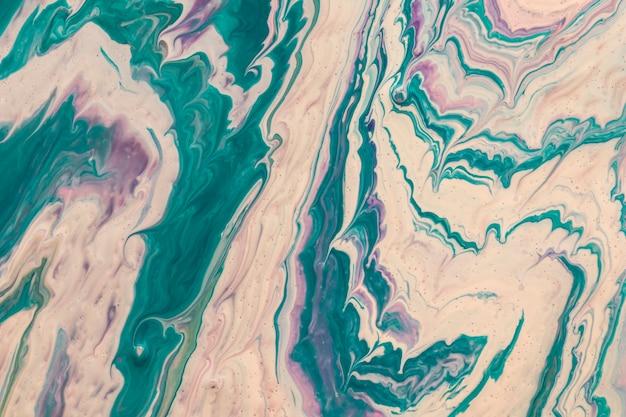 Técnica de drenaje rosa y azul en diseño acrílico