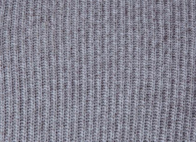 Tejido gris oscuro texturizado para el tejido de fondo.