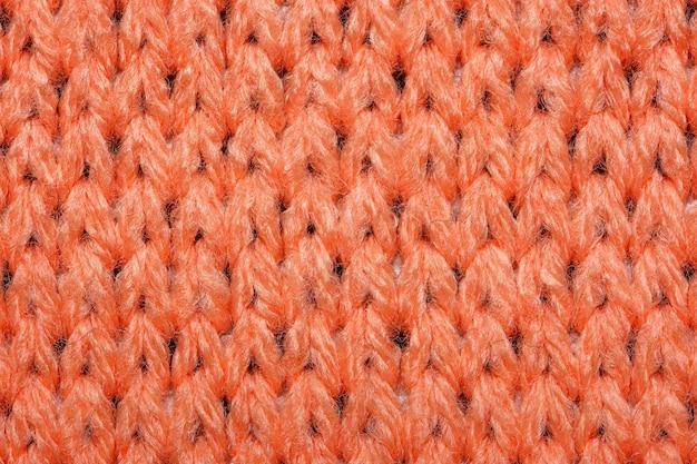 Tejido de punto sintético rojo de cerca. fondo de textura de tejido de punto