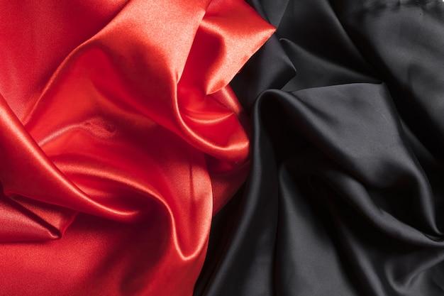 Tejido de seda rojo y material negro para la decoración del hogar.