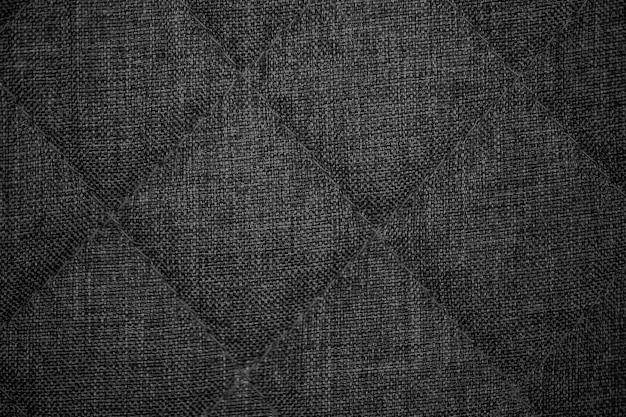 Tejido de textura. fondo de tela de punto gris oscuro.