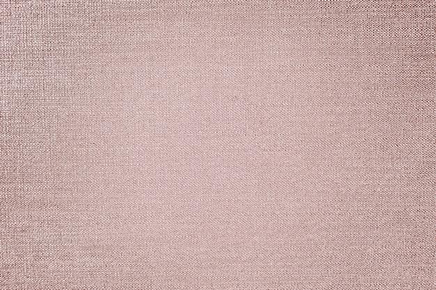 Tela de algodón rosa dorado con textura