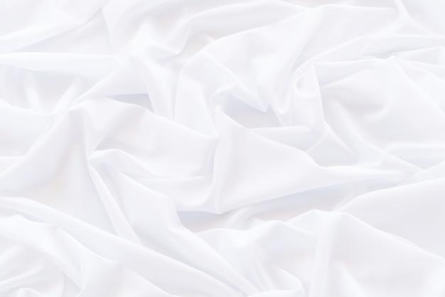 Tela de cortinas blanca abstracta, patrón y detalle acanalados de tela blanca para fondo y abstracto