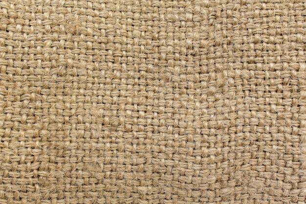 Tela natural de arpillera, fondo marrón.