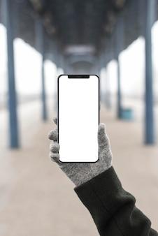 Teléfono de explotación de mano de primer plano