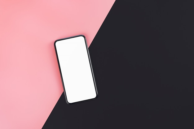 Teléfono inteligente en el fondo de color rosa y negro con pantalla en blanco copia espacio.