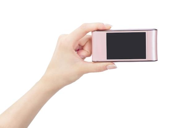 Teléfono móvil en mano femenina