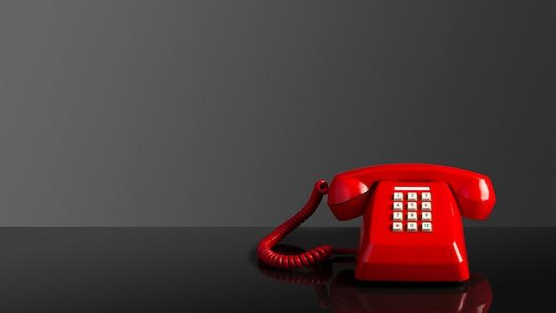 Teléfono viejo vintage rojo sobre fondo negro