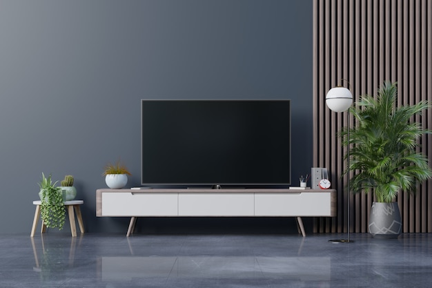 Televisor led en la pared oscura del salón, diseño minimalista.