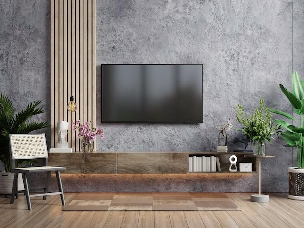 Un televisor en la moderna sala de estar con sillón y planta sobre fondo de muro de hormigón, representación 3d