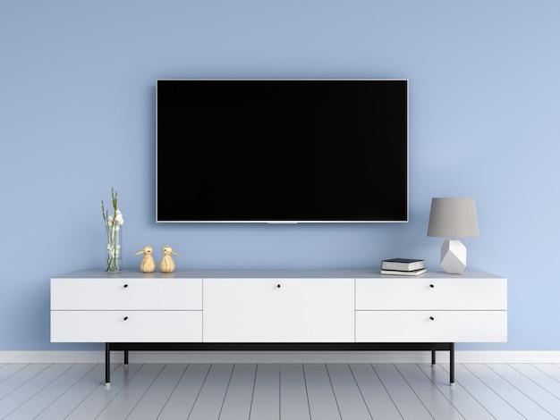 Televisor de pantalla ancha y aparador en salón.