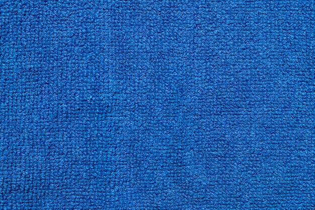 Telón de fondo de textura de tela de tela textil azul suave.