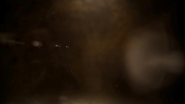 Tema cinematográfico con humo con partículas y fondo oscuro. estilo grunge de lujo y elegante del tema del cine, ilustración 3d