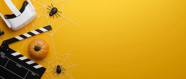 Tema de halloween vr gafas película claqueta tablero calabaza arañas espacio de copia sobre fondo amarillo
