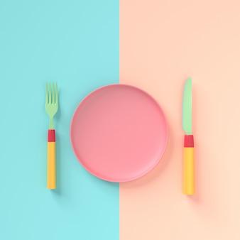 Tenedor con cuchillo y plato color pastel.