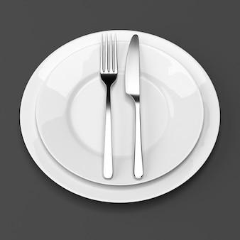 Tenedor y cuchillo con platos