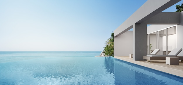 Terraza cerca de sala de estar y piscina en casa de playa moderna