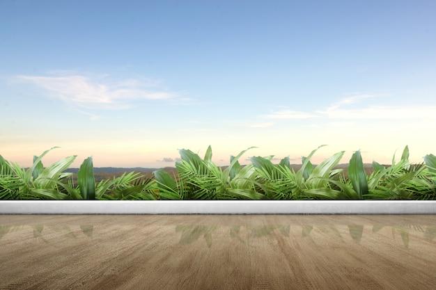 Terraza de la mezquita con piso de madera y plantas verdes.