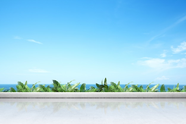 Terraza con piso blanco y plantas verdes con vista al mar.